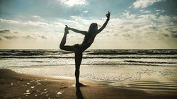Blissfully simple #life I'm not above the cheesy yoga beach pose lol when in Rome.jpg