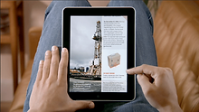 A-user-reading-an-e-magazine-on-iPad-Sou