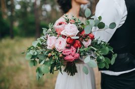 Bridal Photography - Bouquet of pink roses at a wedding ceremony