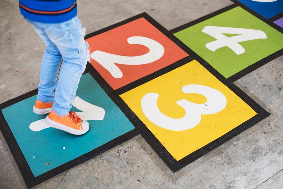 young-kid-playing-hopscotch-P9SXDUN.jpg