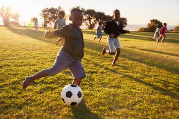 elementary-school-kids-playing-football-