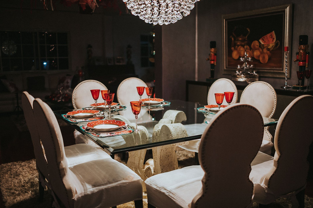 Square dining Area With a Beautiful Chandelier
