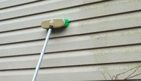 Cleaning-Vinyl-Siding-with-Brush_edited.jpg
