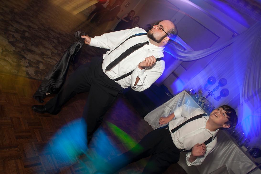 Groomsmen dancing on the dance floor at a wedding party