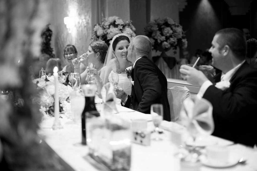 kissing married couple at the head table