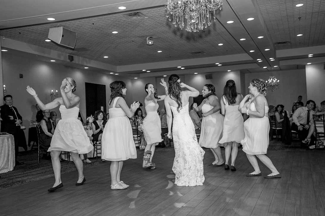 Bridesmaids dancing on the dance floor at a wedding party.
