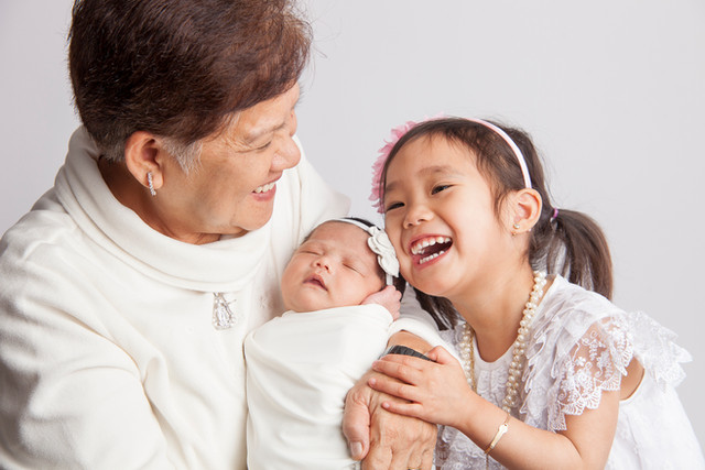 generation family laughing with grandma.jpg