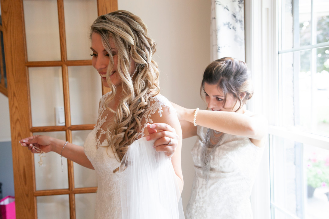 Bride with brides maid getting ready for wedding ceremony