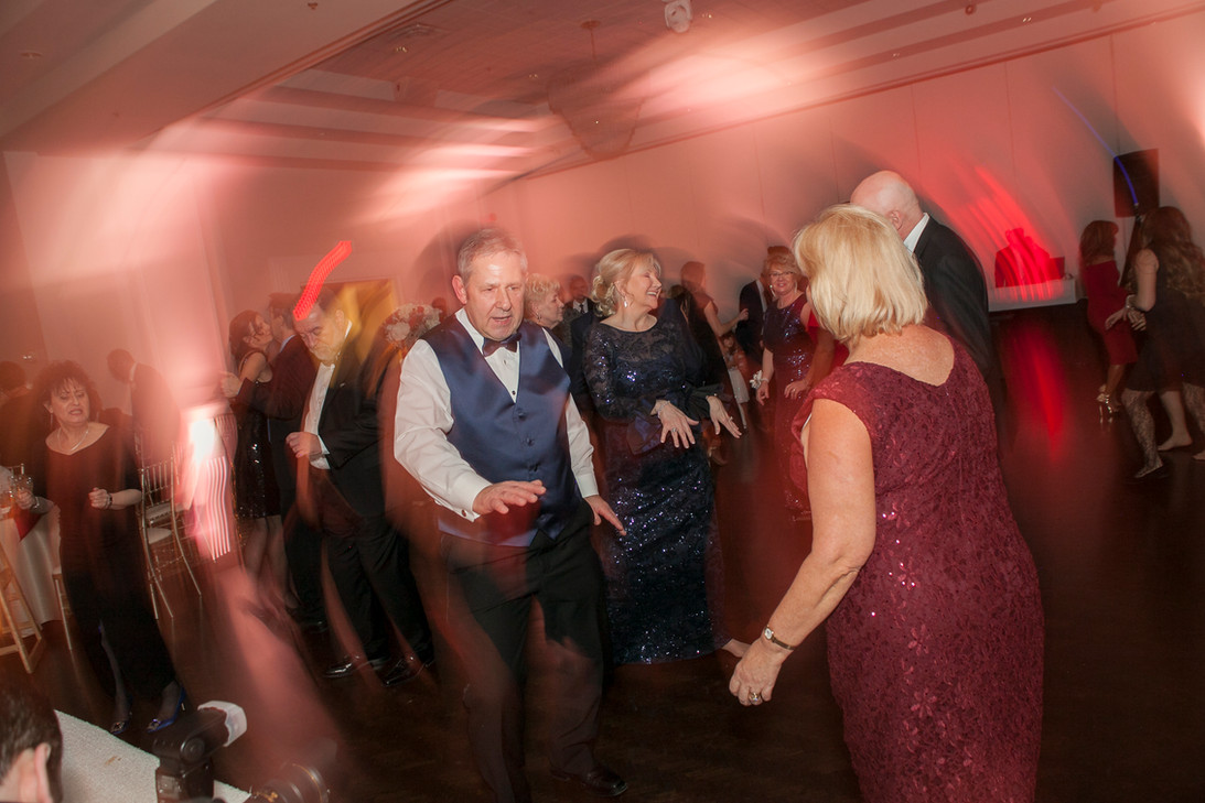 Married couple's parents dancing on the dance floor at a wedding party.