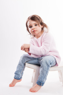 little girl sitting on a stool with jeans.jpg