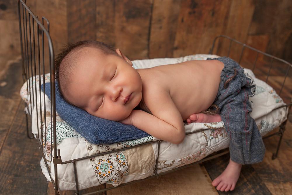 Sleeping baby on mini bed