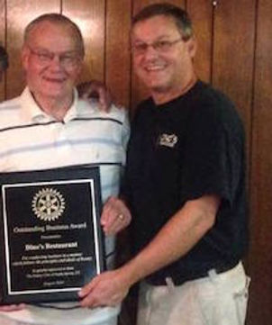 Dino's Seafood Owners Bob & Chris accept the Rotary International Outstanding Business Award