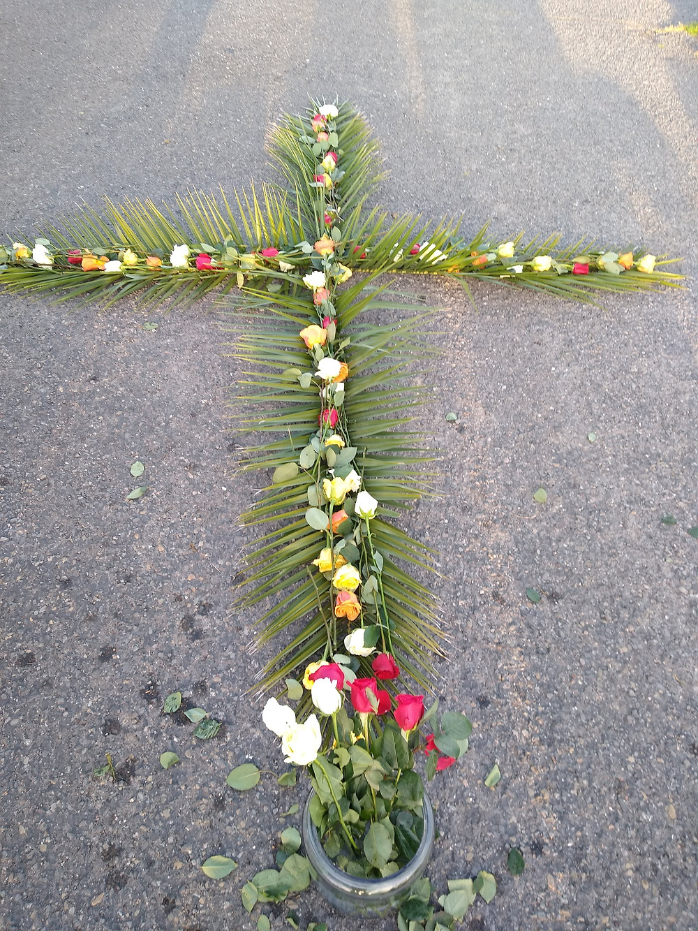 Easter Sunrise Cross formed by palm branches and roses