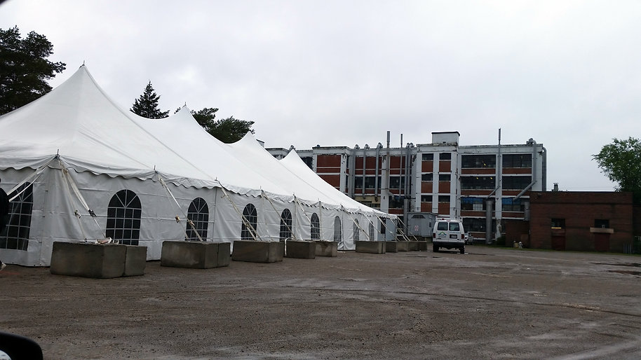 40x120 tent with cement blocks