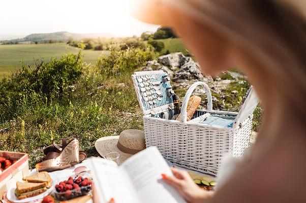 woman-reading-a-book-on-picnic-picjumbo-