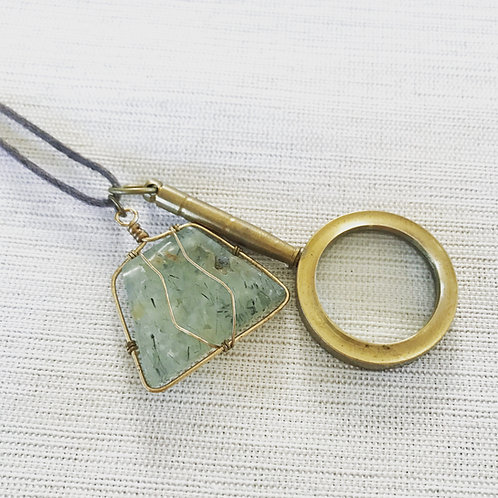 Vintage magnifying glass + green rutilated quartz necklace