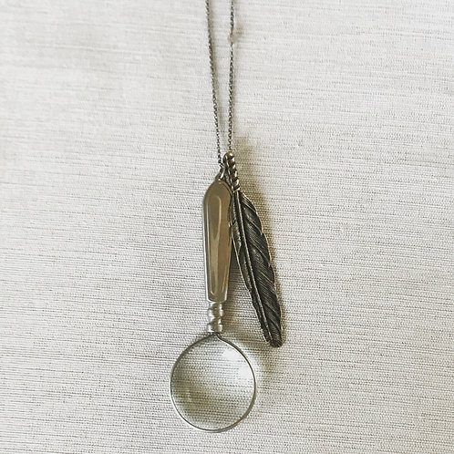 Vintage magnifying glass + oxidized brass feather necklace