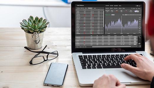 Trade platform, forex trading. Stock exchange market analysis, Man working with a laptop,