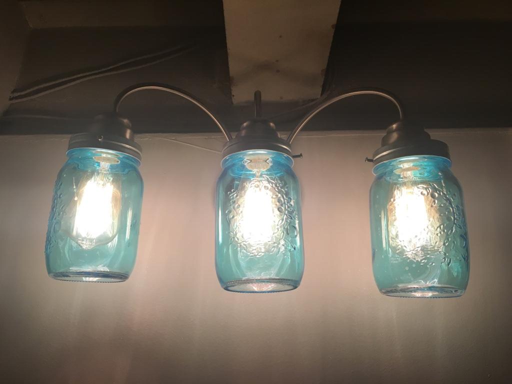 NYC mason jar lights in bathroom