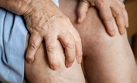 elderly-woman-suffering-knee-pain-PGLZRT