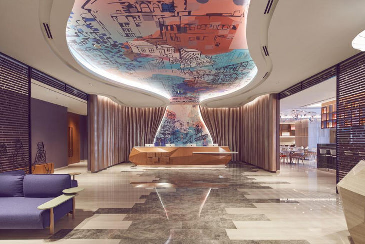 Lobby reception wall to ceiling mural art.