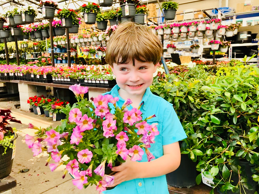 My youngest selecting petunia cultivars at Lowes