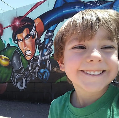Kid enjoys Fabulous 4 mural by Denzone