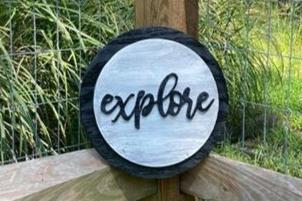 "12"" Black & Distressed Gray Circle Sign ""explore"""