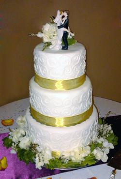 Gold ribbon on white lace fondant