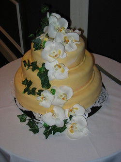 Yellow fondant with Orchids