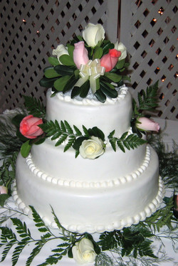 White Fondant with Fresh Flowers and String of Fondant Pearls
