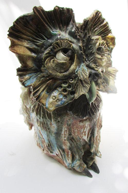 Shy owl sculpture