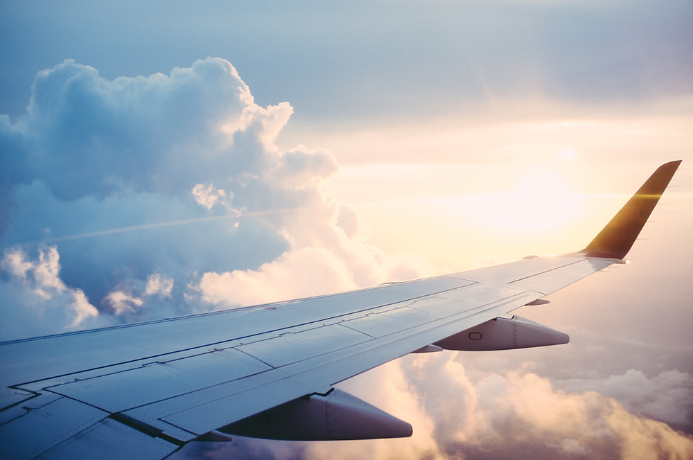 plane wing sunrise