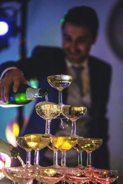 Groom serving champagne