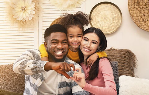 smiling-millennial-family-sofa-home-smil