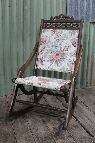 An Antique Foldable Upholstered Timber Rocking Chair