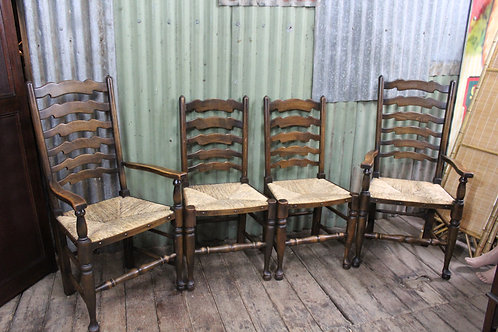 A Vintage Set of 4 French Oak Ladder Back Dining Chairs including 2 Carvers