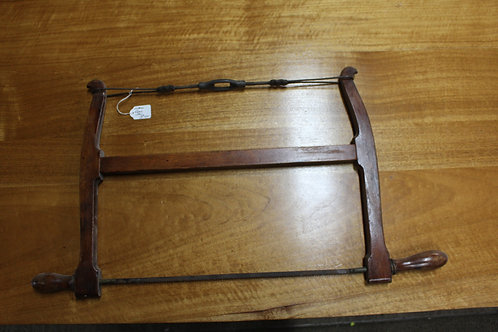 An Antique Hand Saw Band Saw C.Daly