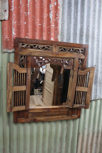 A Carved Balinese Decorative Wall Mirror with Shutters