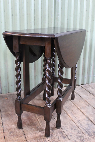 An Antique Jacobean Oak Gate Leg Table with Drop Sides and Barley Twist
