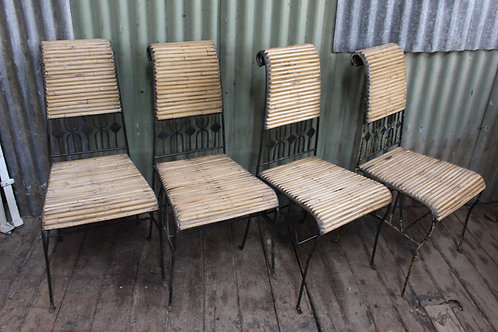 A Set of Four Vintage Wrought Iron & Cane Stackable Chairs