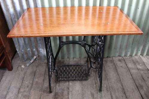 An Oak Hall Table on Singer Cast Iron Treadle Base