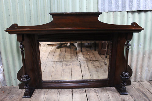 An Antique Over Mantle Mirror with Beveled Edging and Carved Supports