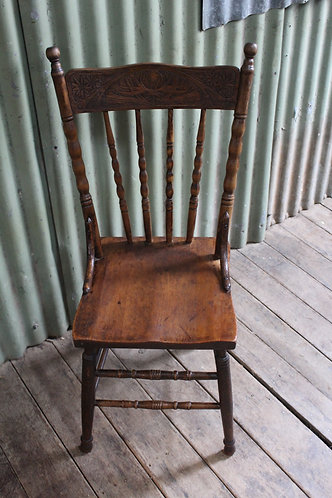 An Antique Spindle Back Country Kitchen Cottage Chair with Pressed Back
