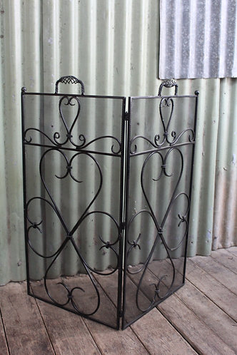A Vintage Foldable Black Wrought Iron Fire Screen