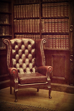 Chesterfield leather armchair in classical library vintage style. Traditional British retro study ro