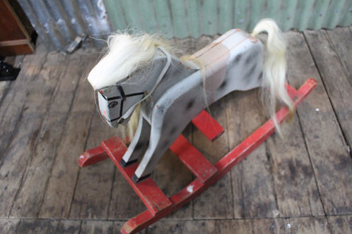 A Retro Vintage Child's Timber Rocking Horse with Natural Horse Hair