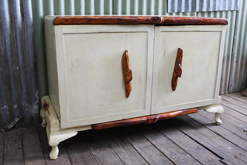 A Retro Quirky Sideboard Cabinet with Natural Tree Branch Trim