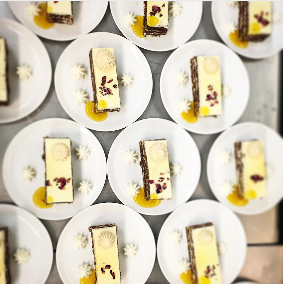 Passion fruit carrot cake with rose petals plated dessert for large event!