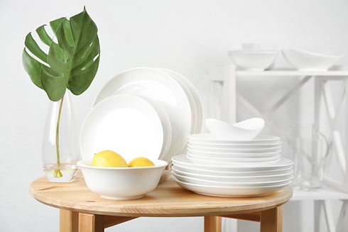Different clean tableware on wooden tabl